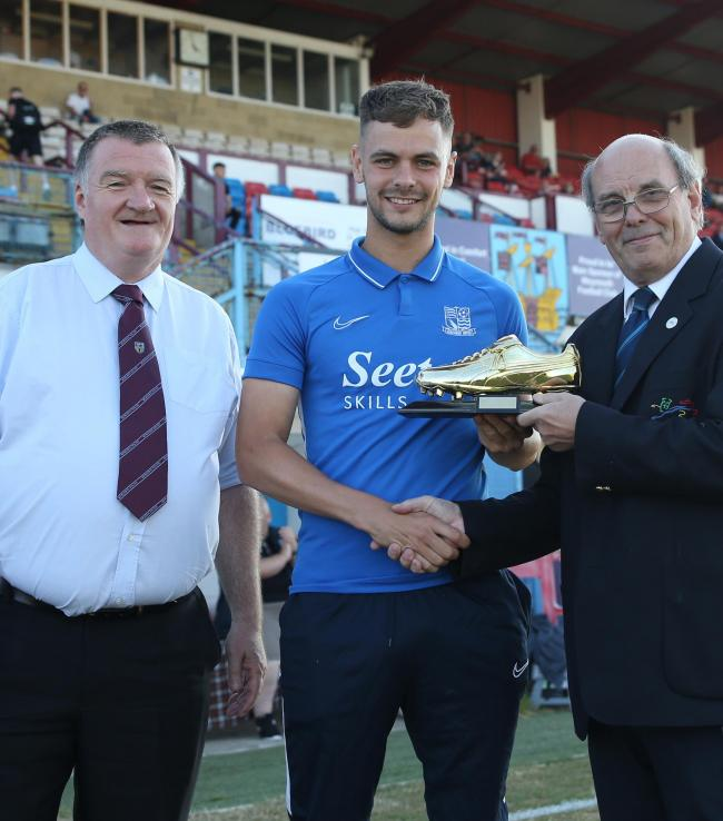 Brandon Goodship, centre, collects his golden boot with Terras' chairman Ian White, left, and secretary Pete Saxby 					            Picture: MARK PROBIN