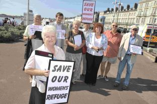 STRONG OPINION: Mary Watson and other campaigners gather names for a petition against the closure of the women's refuge