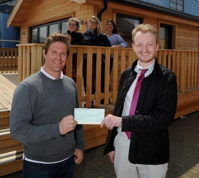 annett Foundation cheque presented to Andrew Simpson Sailing Centre, Richard Percy, left, receives a cheque from reporter James Moules, 30/04/19, Picture: FINNBARR WEBSTER/F20262