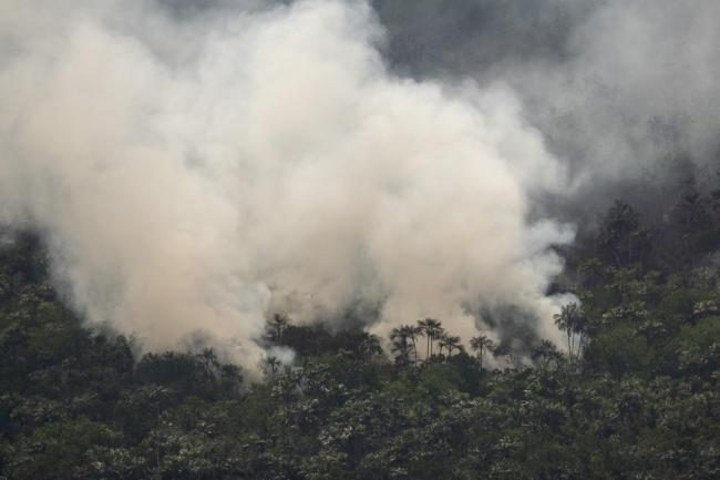 A forest fire burns near Porto Velho, Brazil, Tuesday, Aug. 27, 2019. Fires across the Brazilian Amazon have sparked an international outcry for preservation of the world's largest rainforest. (AP Photo/Victor R. Caivano)