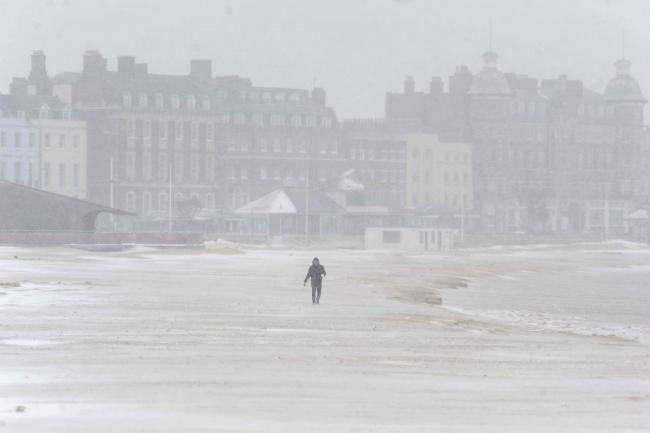 Snow on Weymouth Beach, Dorset, UK Picture by: Finnbarr Webster Photography