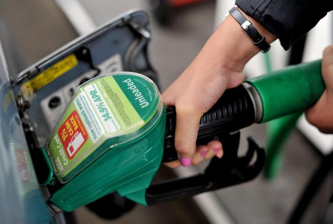 A person using an Asda petrol pump  Picture: Nick Ansell/PA Wire