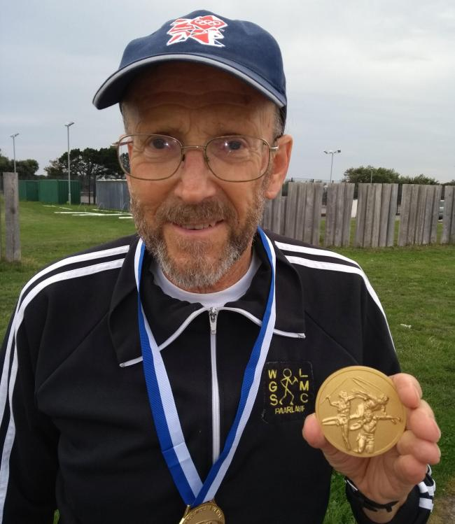 Pete Clarke with his Icosathlon gold medal