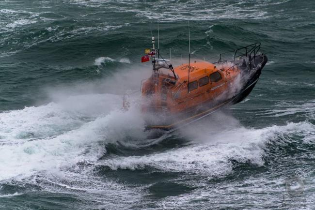 Lifeboat crew respond to fears for man 'scrambling up cliff'
