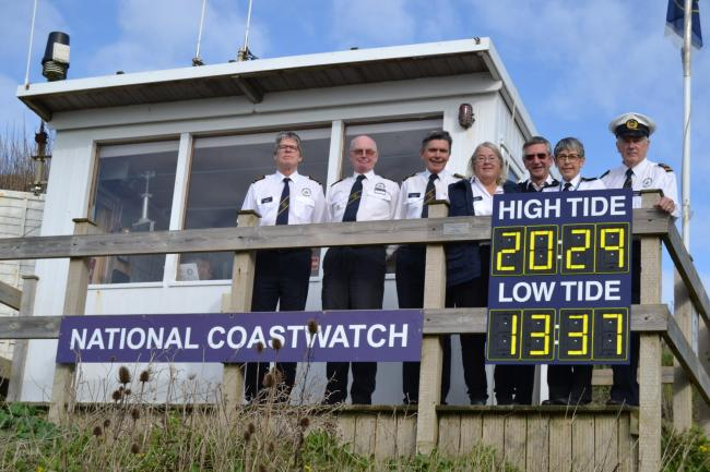 Watchkeepers with the new tide board at the NCI lookout at Burton Bradstock