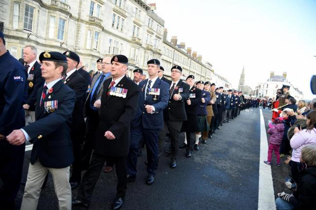Remembrance parade on Weymouth seafront. Picture: Finnbarr Webster