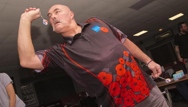 Nigel Davis wore a Remembrance Day darts shirt in the latest Weymouth ADC round                       Picture: SI JUBB