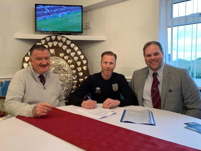 Mark Molesley, centre, has extended his stay at the Terras by a further season Picture: WFC