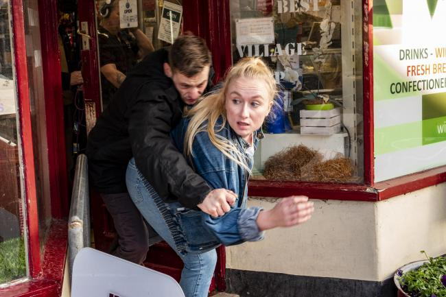 'Robbers' flee the scene after holding up a local shop. Picture: Hard Road Films