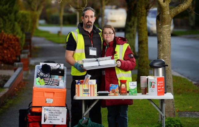 BNPS.co.uk (01202 558833).Pic: BNPS..Pictured: Luke Bird and Rebecca Hobby..Volunteers threatened with prosecution for cooking hot meals for homeless people can continue - but only if they serve vegetarian food..The public-spirited group have been told by