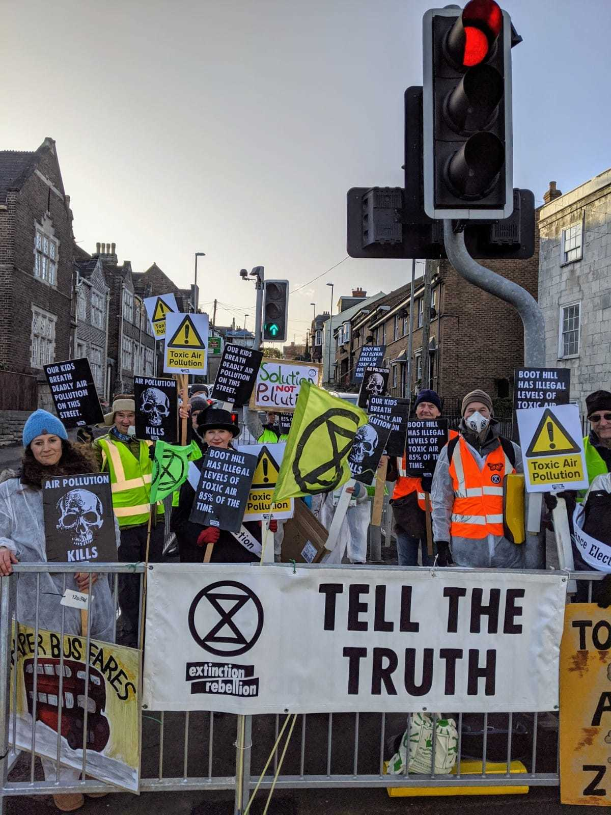 Extinction Rebellion activists protest air quality of busy Weymouth street