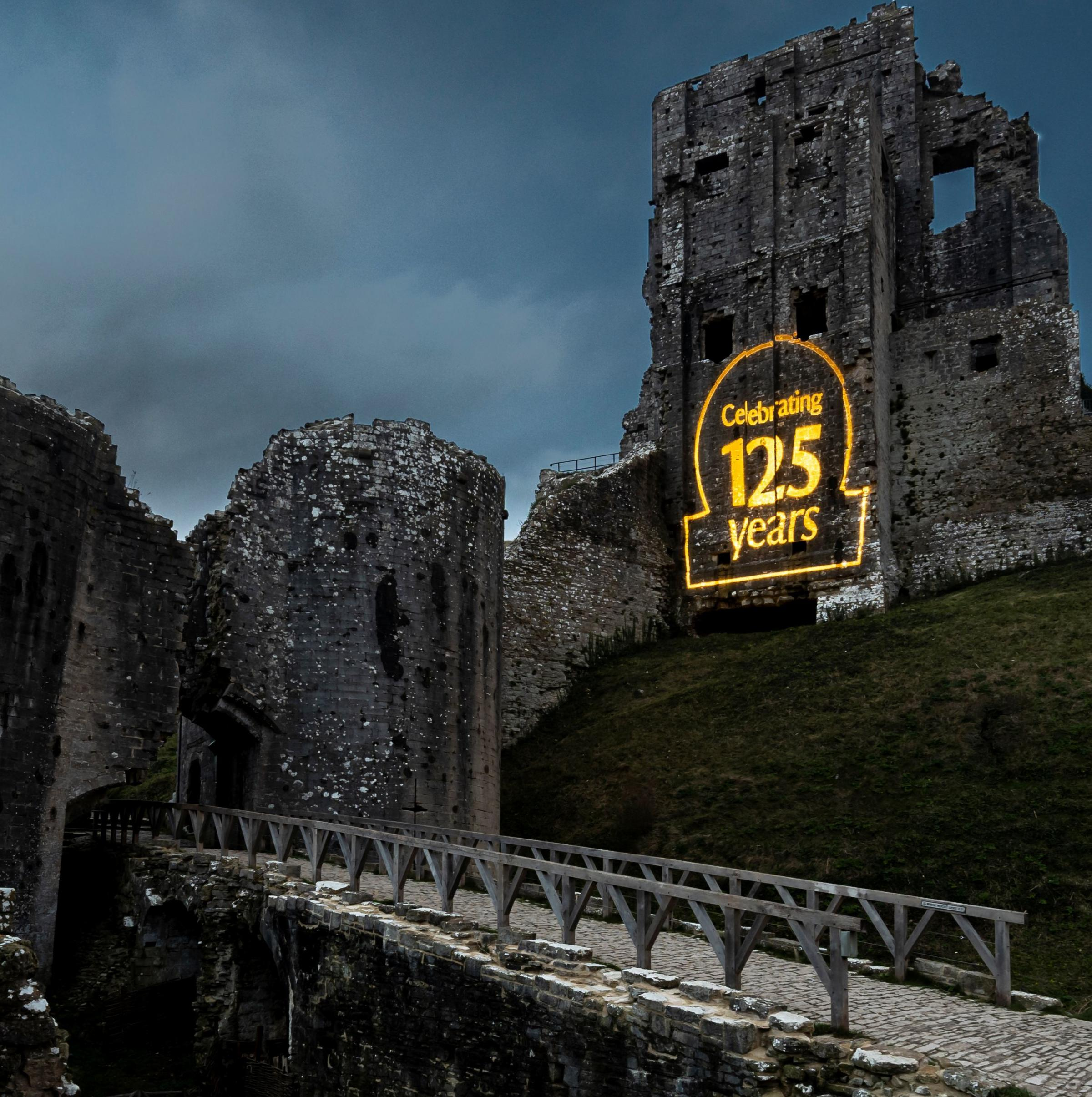 Corfe Castle lit up to celebrate 125 years of the National Trust