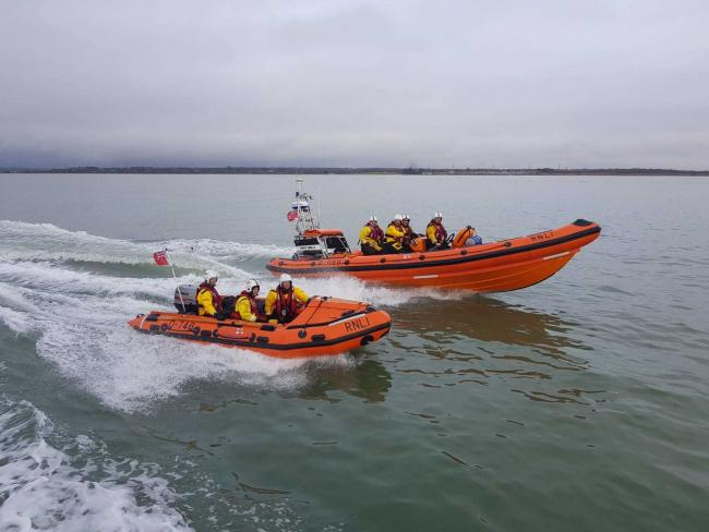RNLI were tasked to teenagers on paddle boards