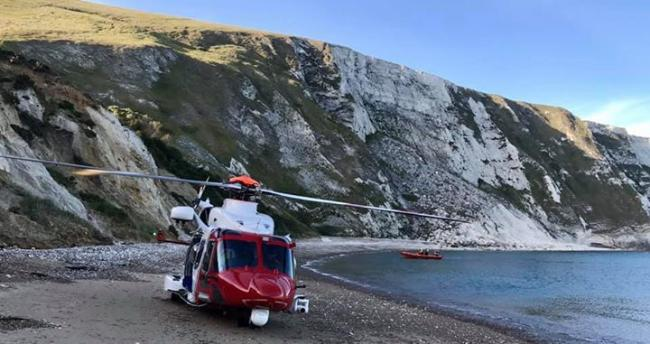 Helicopter arrives at the scene  Picture: LULWORTH COASTGUARD RESCUE TEAM