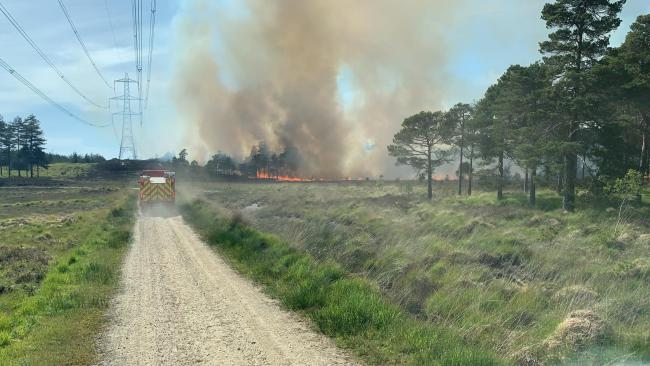 Crews return to scene of huge forest fire after flare-ups