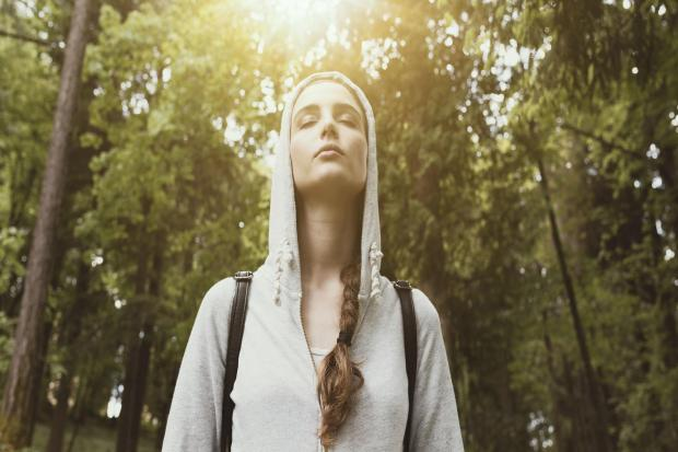 A Generic Photo of woman breathing in while on a walk. See PA Feature TOPICAL Wellbeing Meditation Walks. Picture credit should read: PA Photo/iStock. WARNING: This picture must only be used to accompany PA Feature TOPICAL Wellbeing Meditation Walks.
