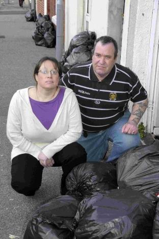 Michelle and Mike Pearce with the uncollected rubbish