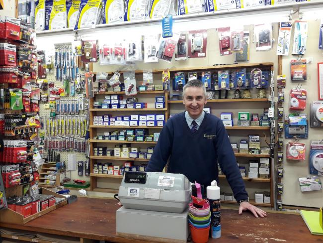 Glenn at the counter in 'normal' times