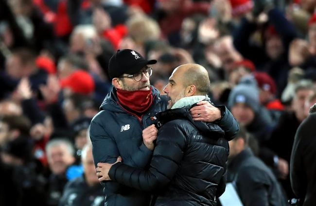 File photo dated 10-11-2019 of Liverpool manager Jurgen Klopp (left) and Manchester City manager Pep Guardiola hug after the final whistle during the Premier League match at Anfield, Liverpool. PA Photo. Issue date: Thursday June 25, 2020. Liverpool secur