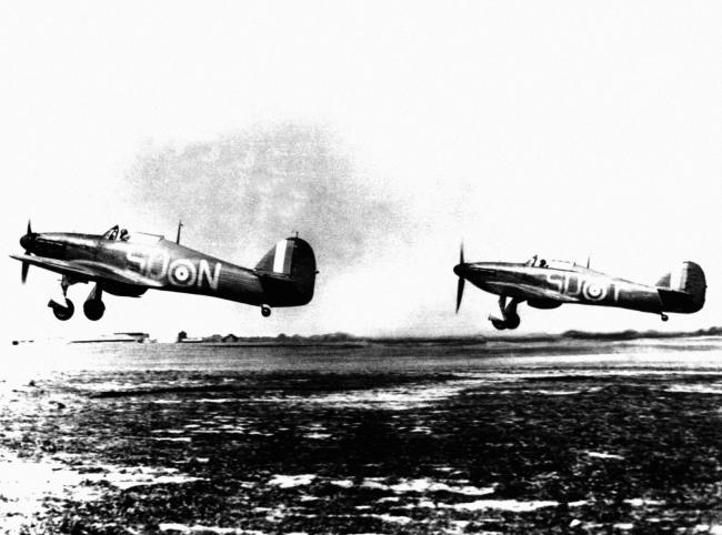 Two RAF Hawker Hurricane MK1 fighters from RAF 79 Squadron taking off from RAF Hawkinge, Kent, during the Battle of Britain, 1940