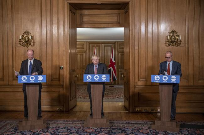 (left to right) Chief Medical Officer Professor Chris Whitty, Prime Minister Boris Johnson and Chief Scientific Adviser Sir Patrick Vallance during a media briefing in Downing Street, London, on coronavirus (COVID-19). PA Photo. Picture date: Wednesday Se