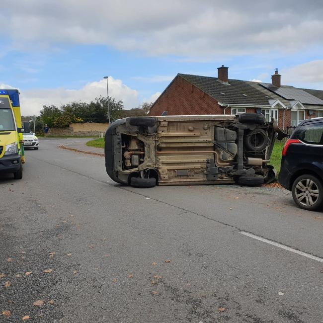 The van was overturned following a collision Picture: North Dorset Police
