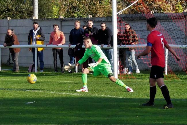 Jordon Scadding, centre, kept Bridport in the game with a series of marvellous saves 				     Picture: STEPHEN BARRETT
