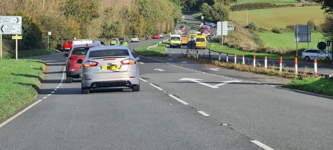 Emergency services at the scene of a two-vehicle crash on the A30 Babylon Hill between Yeovil and Sherborne.