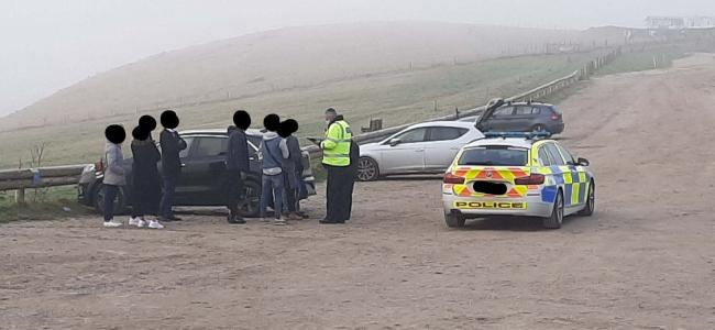 Police officers issued fines after people from Coventry travelled to Durdle Door. Picture: Lulworth Estate