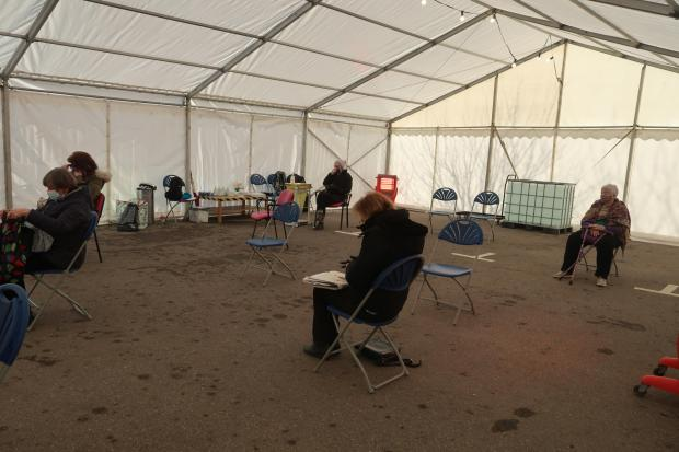 Dorset Echo: West Dorset residents waiting after receiving the first Covid-19 jab