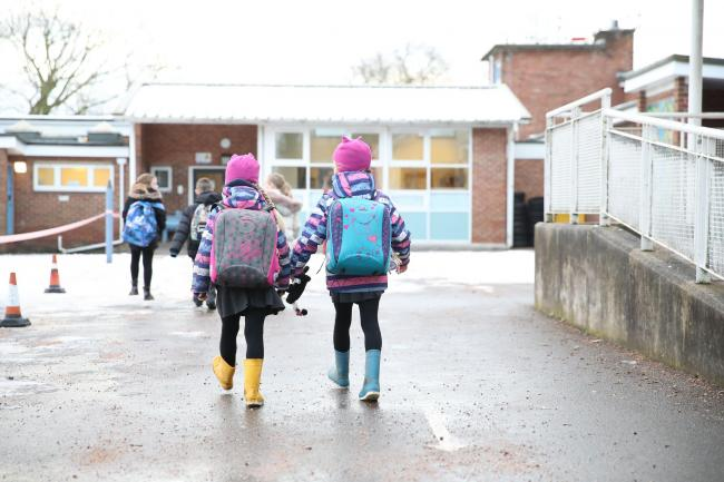 Pupils arrive at school