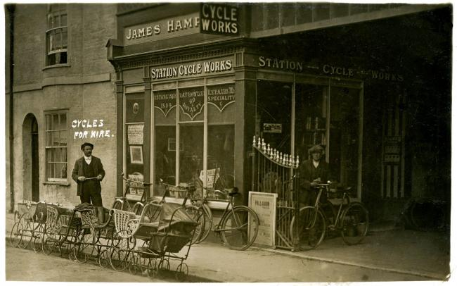 Station cycle shop of long-gone island railway among more shops from the past