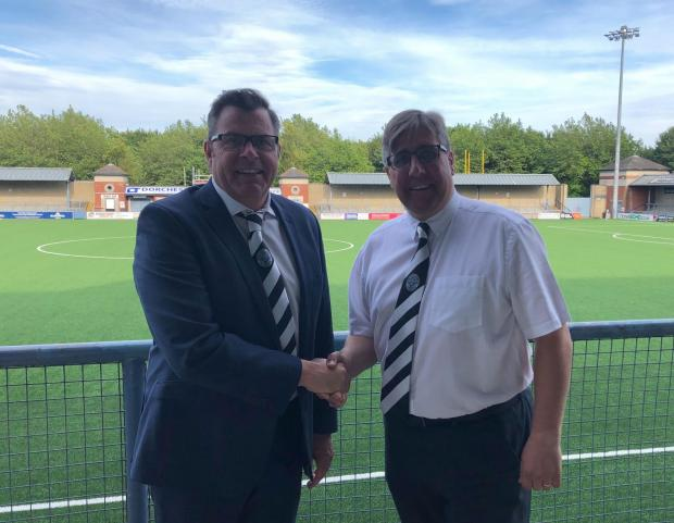 Dorset Echo: Matt Lucas, right, handed over to incumbent Dorchester Town chairman Scott Symes, left, in 2019 Picture: DTFC