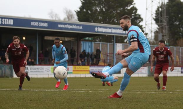Dorset Echo: Josh McQuoid scored from the spot to give Weymouth the lead Picture: MARK PROBIN
