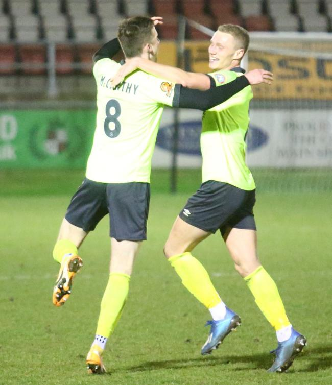 Jake McCarthy, left, celebrates scoring at Dagenham 		            Picture: MARK PROBIN