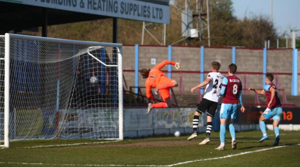 Dorset Echo: Sean Shields' floated cross nestles in the far corner Picture: MARK PROBIN