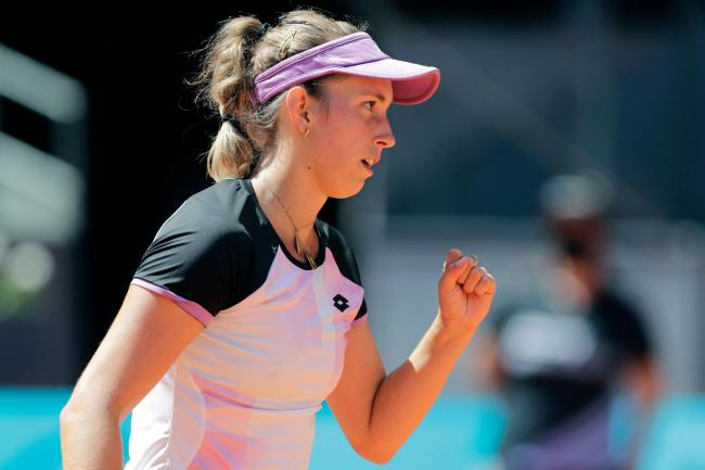 Elise Mertens celebrates winning a point during her victory over Simona Halep