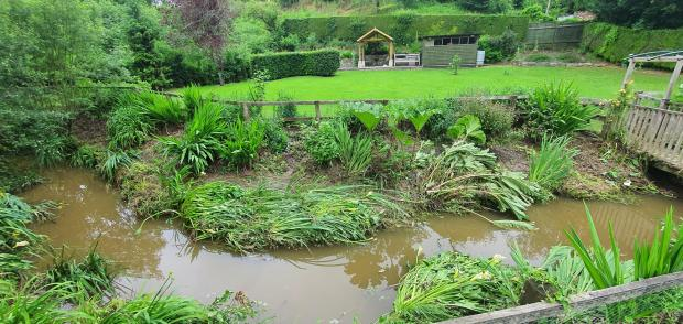 Dorset Echo: River levels have since dropped, but the damage is evident.  Photo: Anna Vining