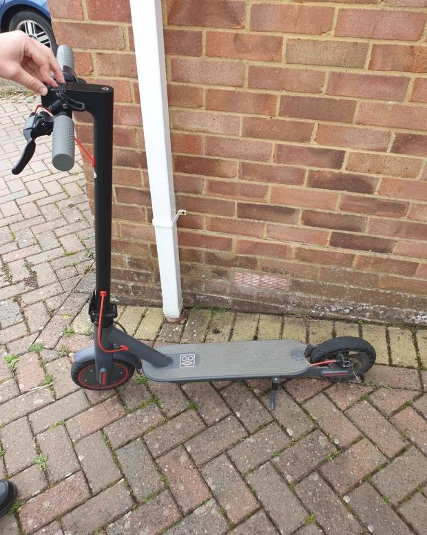 Dorset Echo: A e-scooter rider was stopped by patrolling police officers in a residential area on Tuesday, July 6. Dorset Police say they are illegal to ride around the area. Picture: Purbeck Police