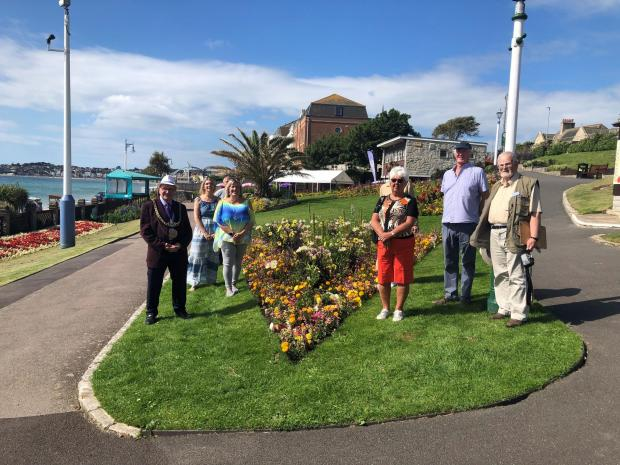 Dorset Echo: Mayor Colin Huckle, Dawn Rondeau of We Are Weymouth, Judges of Britain in Bloom and friends of Greenhill Gardens Photo: Dorset Echo