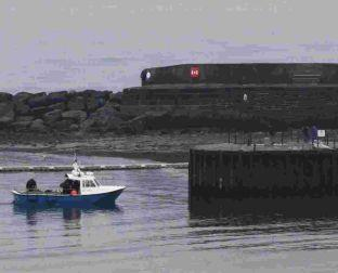 The dive boat Blue Turtle returns to Lyme Regis after the tragedy