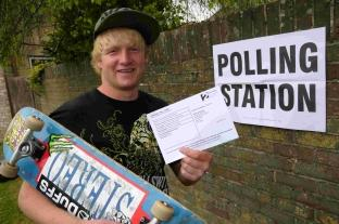 First time voter Laurie Thomas with his polling card