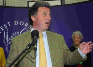 Triumphant Conservative candidate Oliver Letwin makes a point during his victory speech in Dorchester