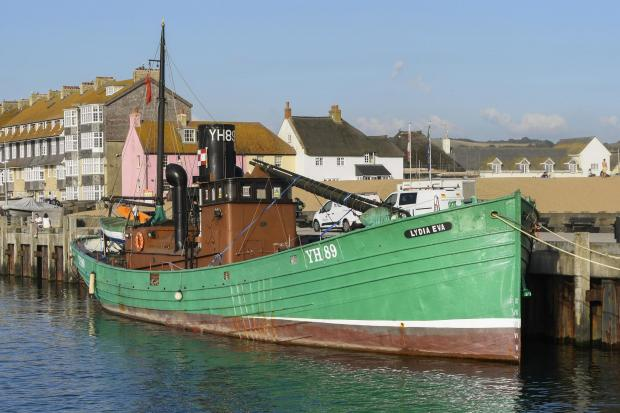 Dorset Echo: The last steam herring dinghy in the world, the Lydia Eva docked in West Bay before being used for filming at Lyme Regis for the new movie Wonka.  September 18, 2021. Photo credit: Graham Hunt Photography
