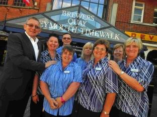 Brewers Quay director Roger Dalton with long-serving staff members