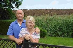 Tony and Norma Lee with the large soil bank at the bottom of their garden