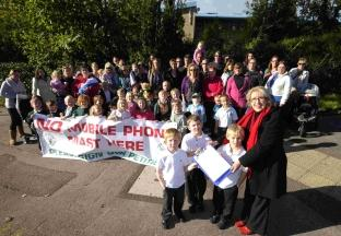 Helen Toft with parents and children outside  Holy Trinity School with the petition against the mobile phone mast
