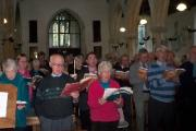 People singing at St Laurence Church, Upwey.