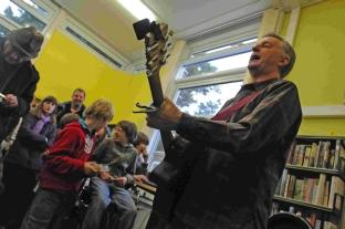 Billy Bragg sings in Charmouth Library