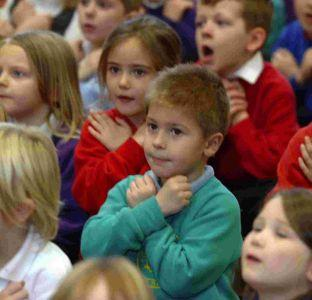 Children at Wyke Regis Infants School sign their songs in a world record bid